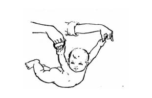 We lift the baby by the hand from a prone position on the tummy. The child holds on to the rings